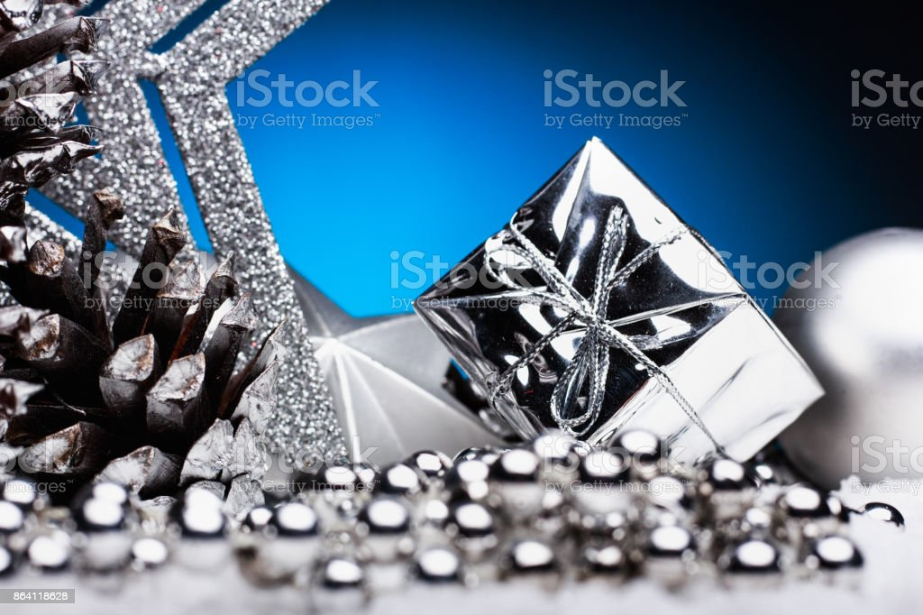 Christmas composition of Christmas tree toys on a blue background royalty-free stock photo