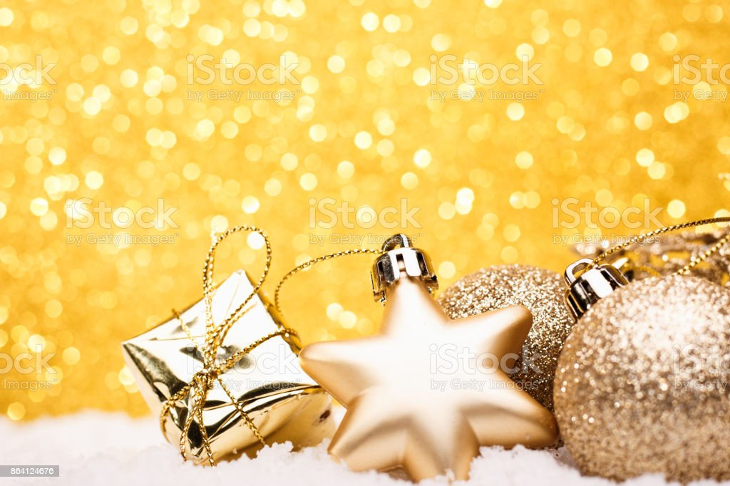Christmas composition of Christmas tree toys on a gold background royalty-free stock photo