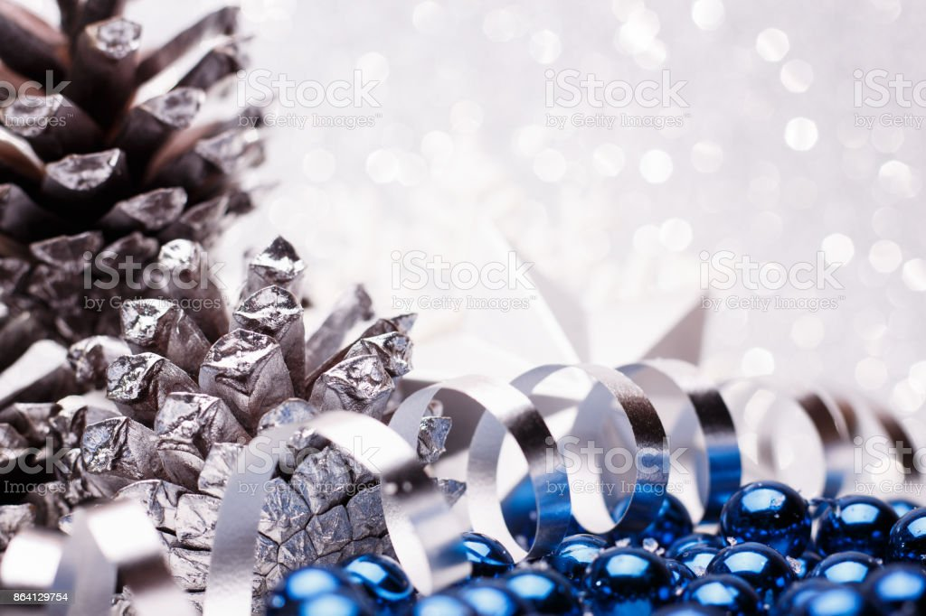Christmas composition of Christmas tree toys on a silver background royalty-free stock photo