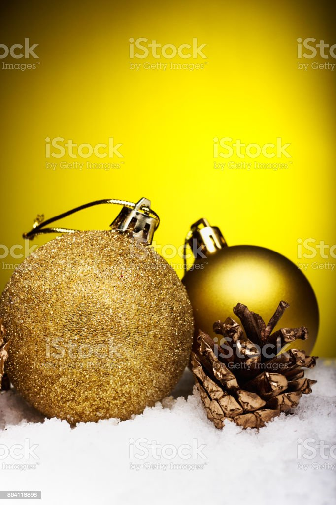 Christmas composition of Christmas tree toys on a yellow background royalty-free stock photo