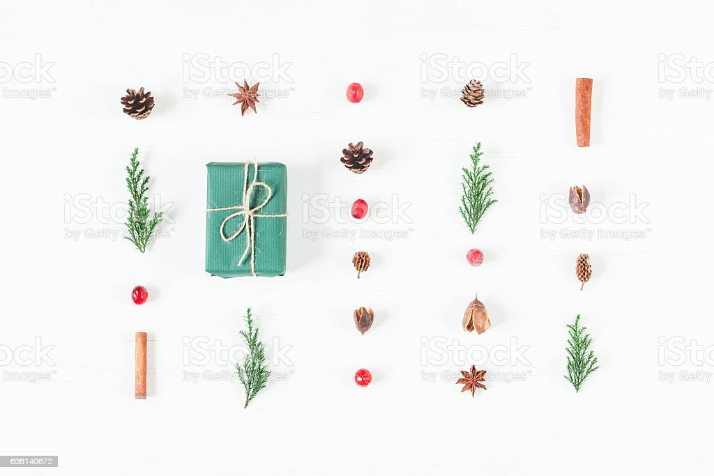 Christmas composition of pine cones, cypress branches, cranberry, gift stock photo
