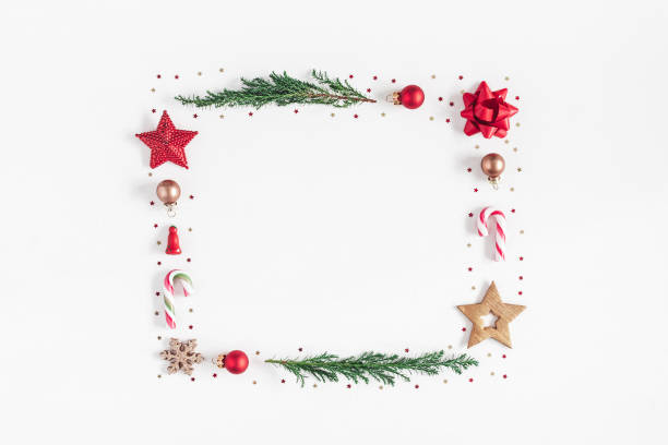 Christmas composition on white background. Flat lay, top view Christmas composition. Frame made of christmas tree branches, red and golden decorations on white background. Flat lay, top view, copy space candy cane stock pictures, royalty-free photos & images