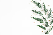 istock Christmas composition. Pattern made of fir tree branches, golden decorations on white background. Christmas, winter, new year concept. Flat lay, top view, copy space 1184779885