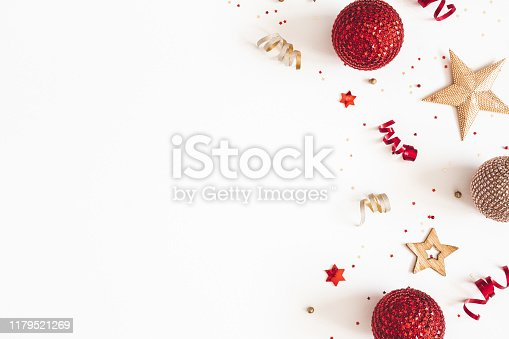 1076057502 istock photo Christmas composition. Red and golden decorations on white background. Christmas, winter, new year concept. Flat lay, top view, copy space 1179521269