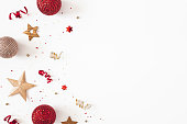 istock Christmas composition. Red and golden decorations on white background. Christmas, winter, new year concept. Flat lay, top view 1285648944