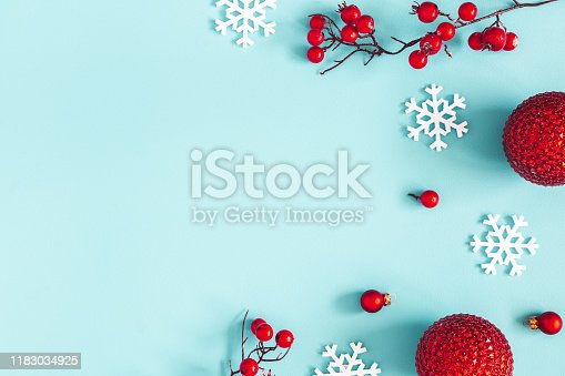 Christmas composition. Red balls, snowflakes on blue background. Christmas, winter, new year concept. Flat lay, top view, copy space
