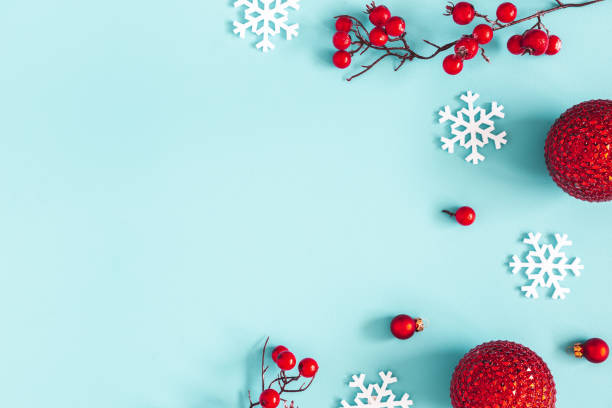 Christmas composition. Red balls, snowflakes on blue background. Christmas, winter, new year concept. Flat lay, top view, copy space stock photo