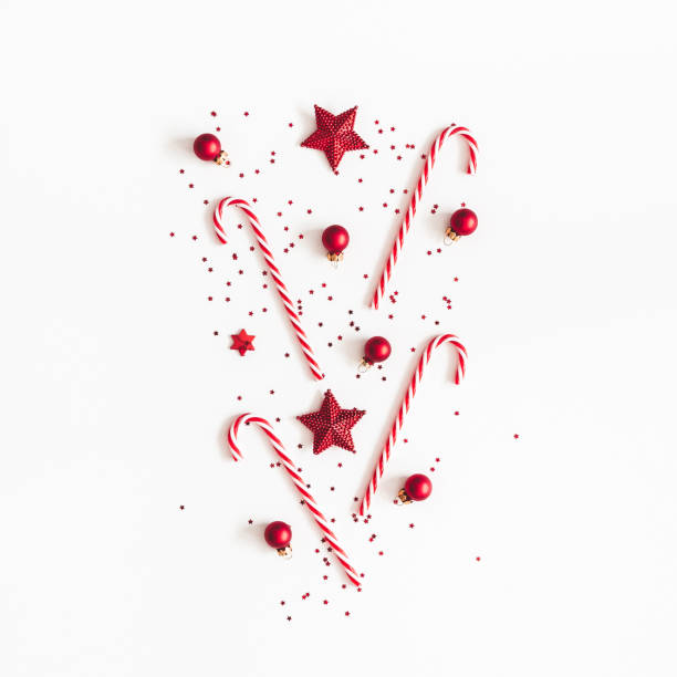 Christmas composition. Red decorations on white background. Christmas, winter, new year concept. Flat lay, top view Christmas composition. Red decorations on white background. Christmas, winter, new year concept. Flat lay, top view candy cane stock pictures, royalty-free photos & images