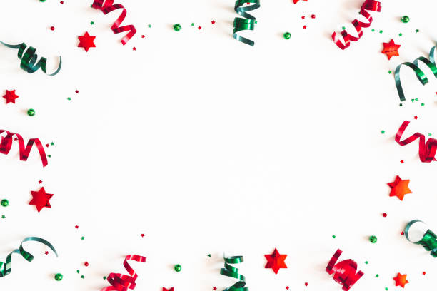 Christmas composition. Ribbon decorations on white background. Christmas, winter, new year concept. Flat lay, top view, copy space stock photo