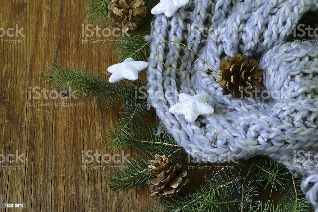 Christmas composition with a knitted scarf and decorations royalty-free stock photo
