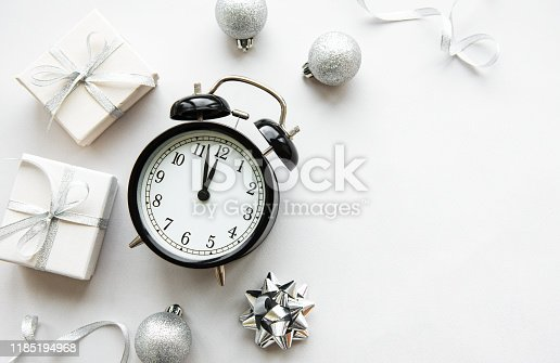 1139289535 istock photo Christmas composition with alarm clock and decorations 1185194968