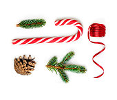 istock Christmas composition  with fir tree branches, red ribbon and Christmas Candy cane  on white background.  Flat lay. Top view 1051032224