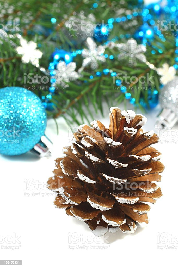Christmas composition with pinecone and blue ball over white royalty-free stock photo