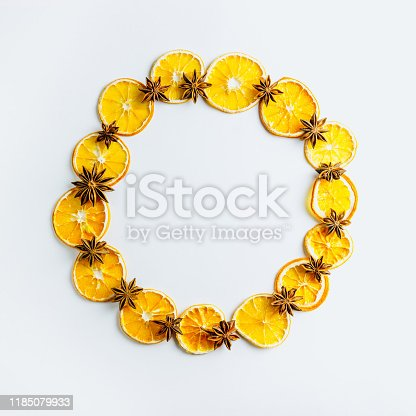 istock Christmas composition. Wreath made of dried oranges and anise stars on white background. Christmas, winter, new year concept. Flat lay, copy space Christmas minimal concept. 1185079933