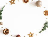 istock Christmas composition. Wreath made of fir tree branches, golden decorations on white background. Christmas, winter, new year concept. Flat lay, top view 1285648938