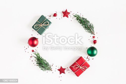 1060169304 istock photo Christmas composition. Wreath made of gifts, fir tree branches, red decorations on white background. Christmas, winter, new year concept. Flat lay, top view, copy space, square 1060169304