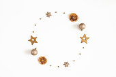 istock Christmas composition. Wreath made of golden decorations on white background. Christmas, winter, new year concept. Flat lay, top view 1285648948