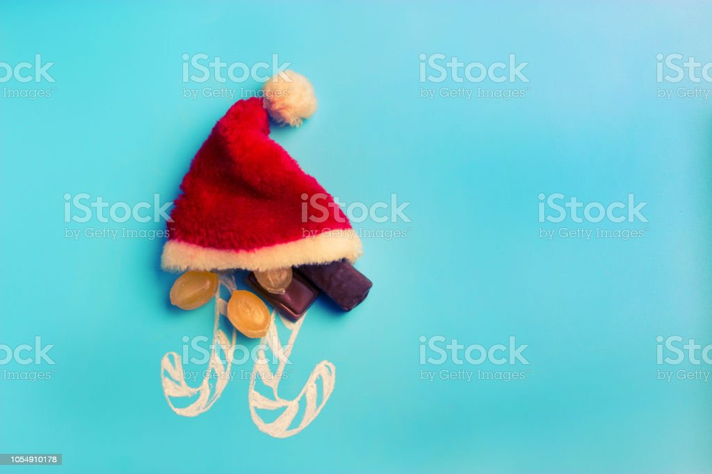 christmas concept. sweets santa hat with copy space stock photo