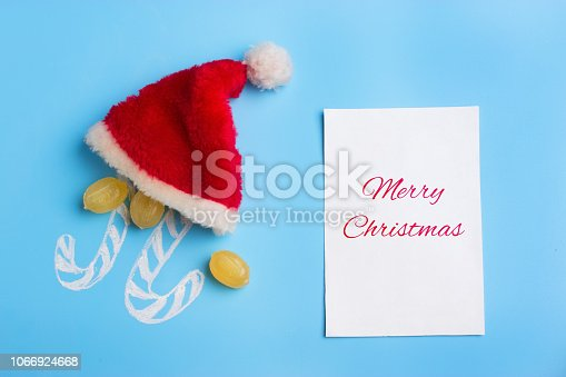 istock christmas concept. sweets santa hat with merry christmas sign 1066924668