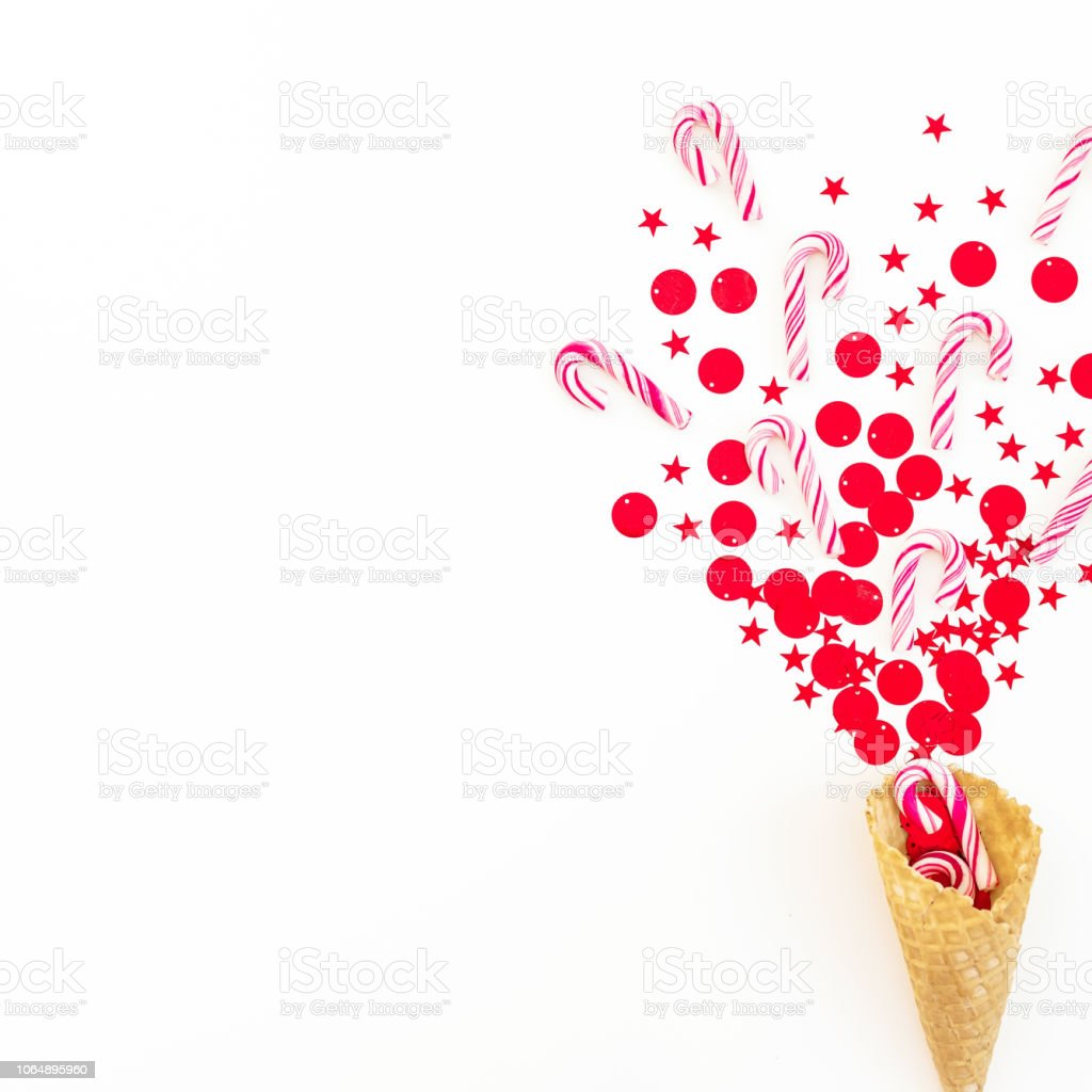 Christmas Concept With Red Confetti Candy Canes And Waffle Cone On