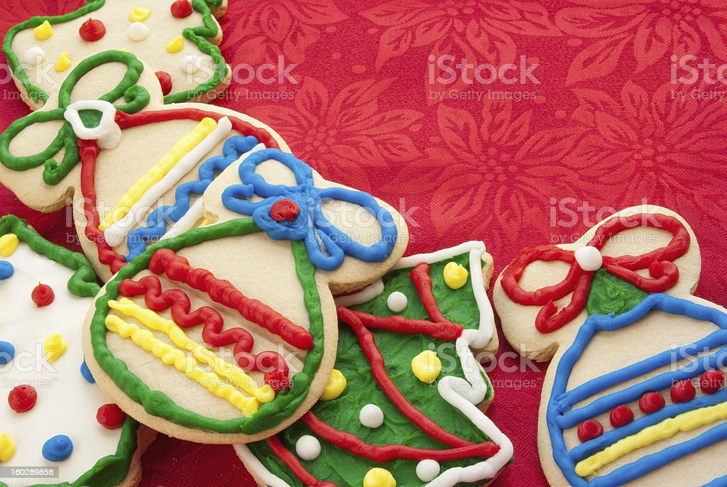 Christmas cookie border with a red holiday poinsettia fabric background royalty-free stock photo