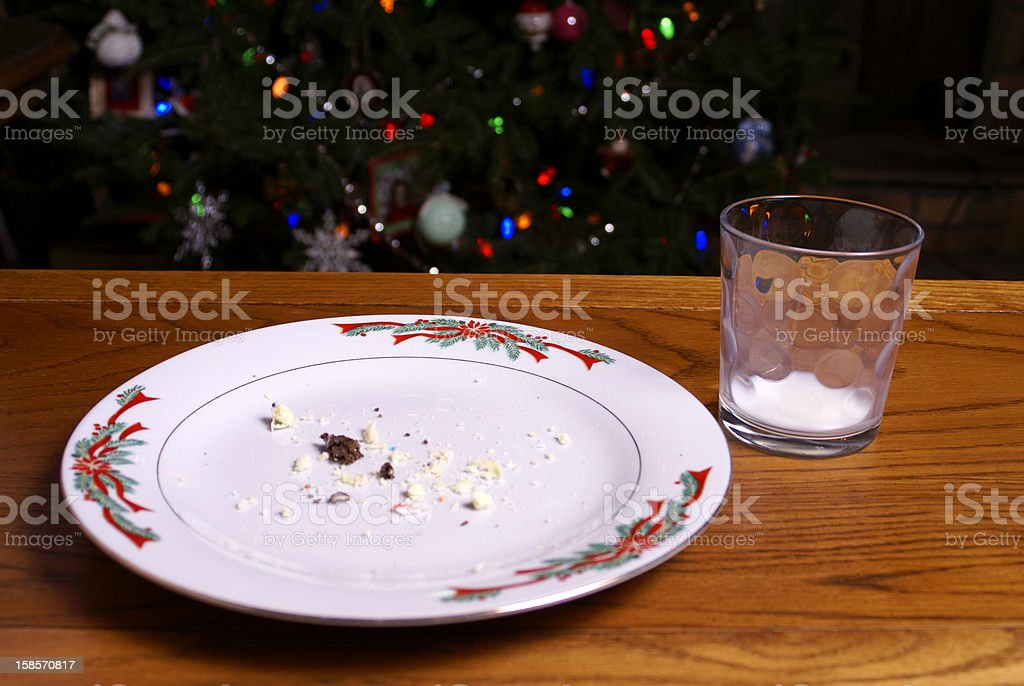 Christmas Cookie Crumbs and Empty Milk Glass stock photo