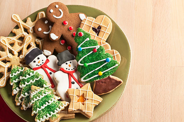 christmas cookie holiday plate featuring tree, gingerbread, snowman, snowflake desserts - christmas cookies stock pictures, royalty-free photos & images