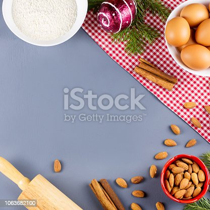 istock Christmas cookie ingredients, rolling pin and cookie cutters. Christmas cooking concept. Copy space 1063682100