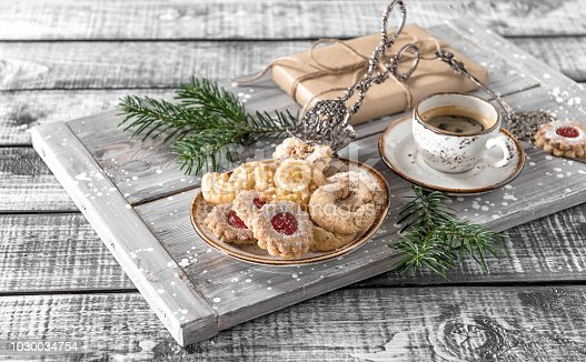 istock Christmas cookies coffee decorations wooden background 1030034754