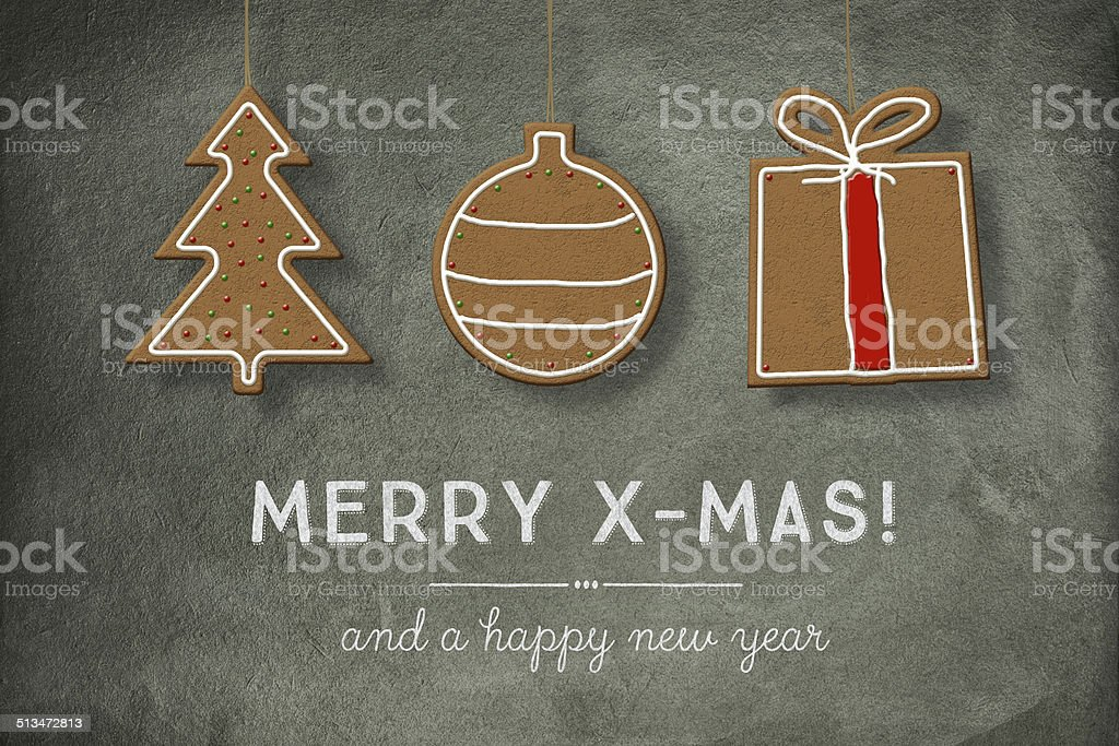 Christmas Cookies hanging in front of Blackboard stock photo