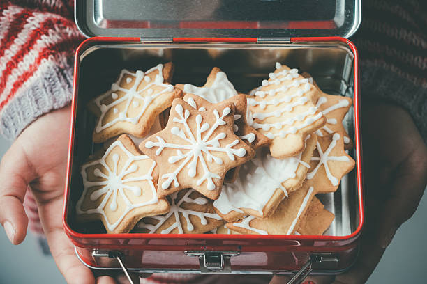 christmas cookies in a metallic child lunch box - christmas cookies stock pictures, royalty-free photos & images