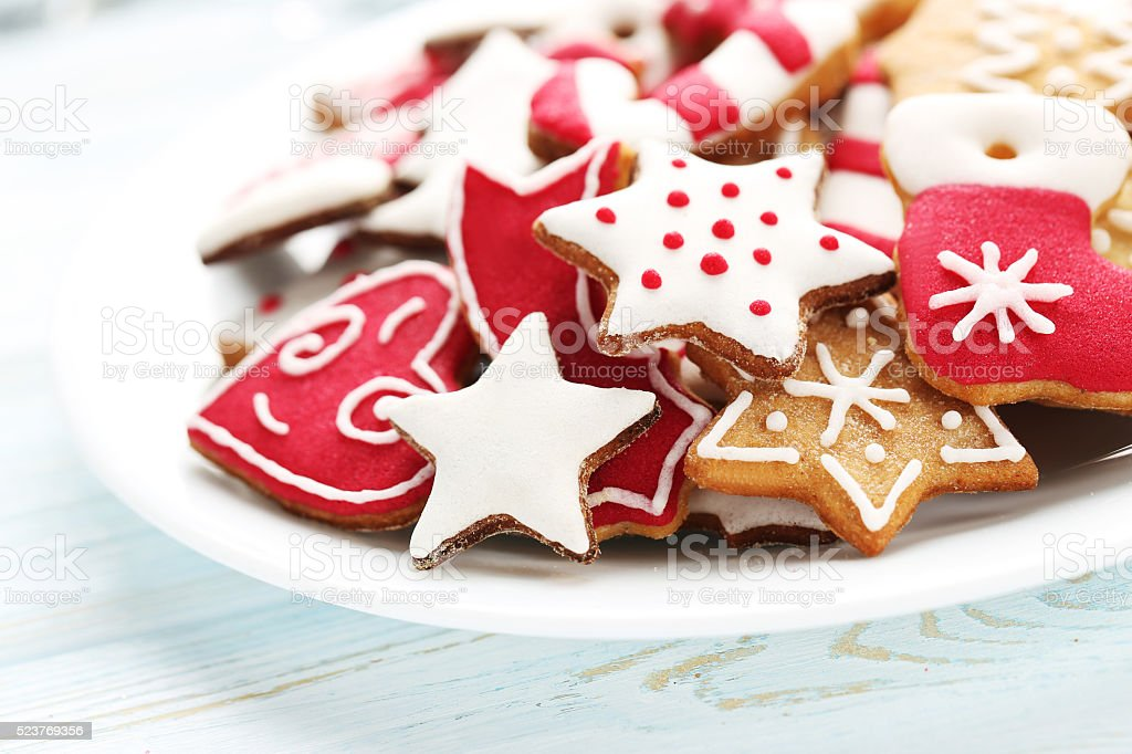 Christmas cookies in plate on a blue wooden table stock photo