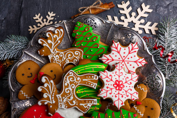 christmas cookies of different shapes and with sugar icing. view from above. - christmas cookies stock pictures, royalty-free photos & images