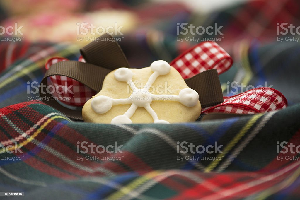 Christmas cookies on red and bule tartan stock photo