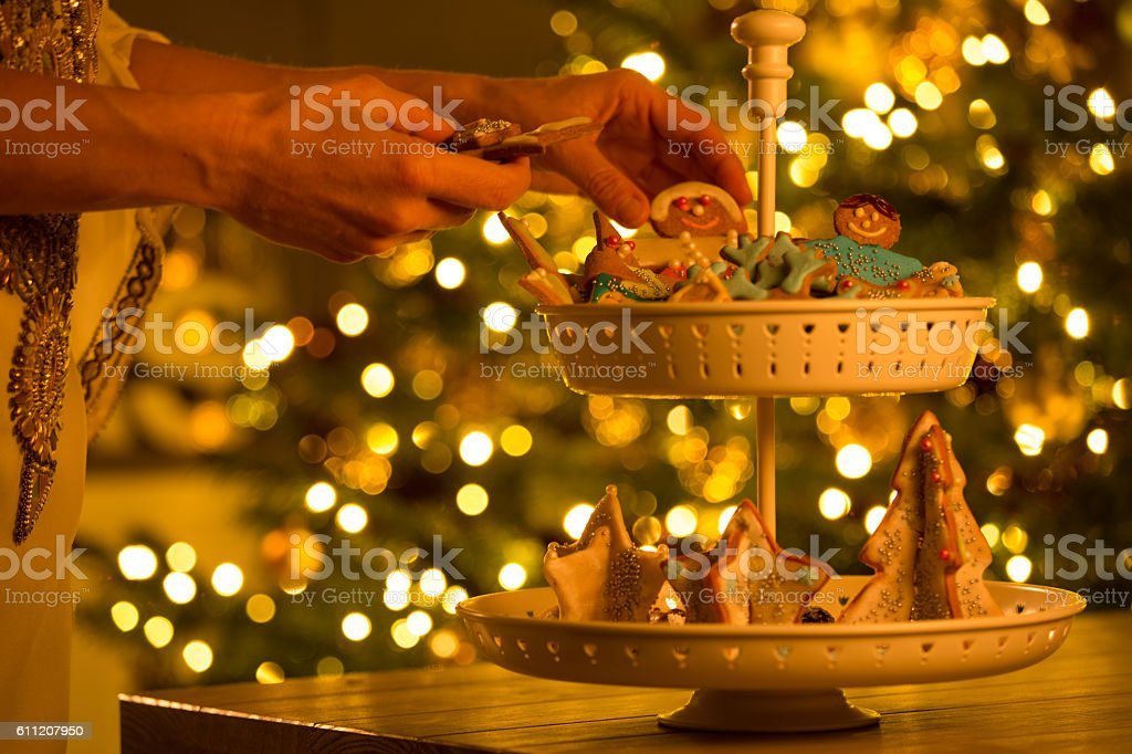 christmas cookies on two tiered cake stand stock photo