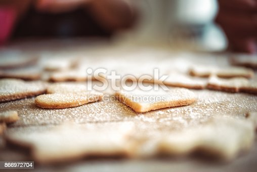 istock christmas cookies on wooden table 866972704