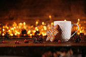 Cup of hot chocolate or cocoa with gingerbread cookie christmas composition on vintage wooden table background