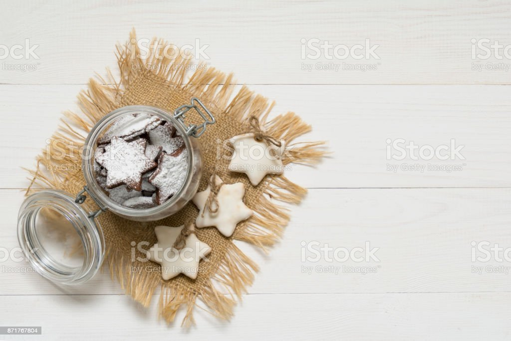 Christmas cookies with sugar-powder and sugar-glaze on white wooden background stock photo