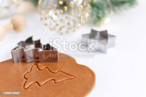istock Christmas cooking background - selective focus of homemade gingerbread cookies dough 1089846562