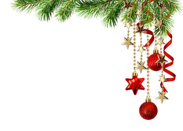 christmas corner arrangement with green pine twigs hanging red decorations and silk twisted ribbons - róg zdjęcia i obrazy z banku zdjęć