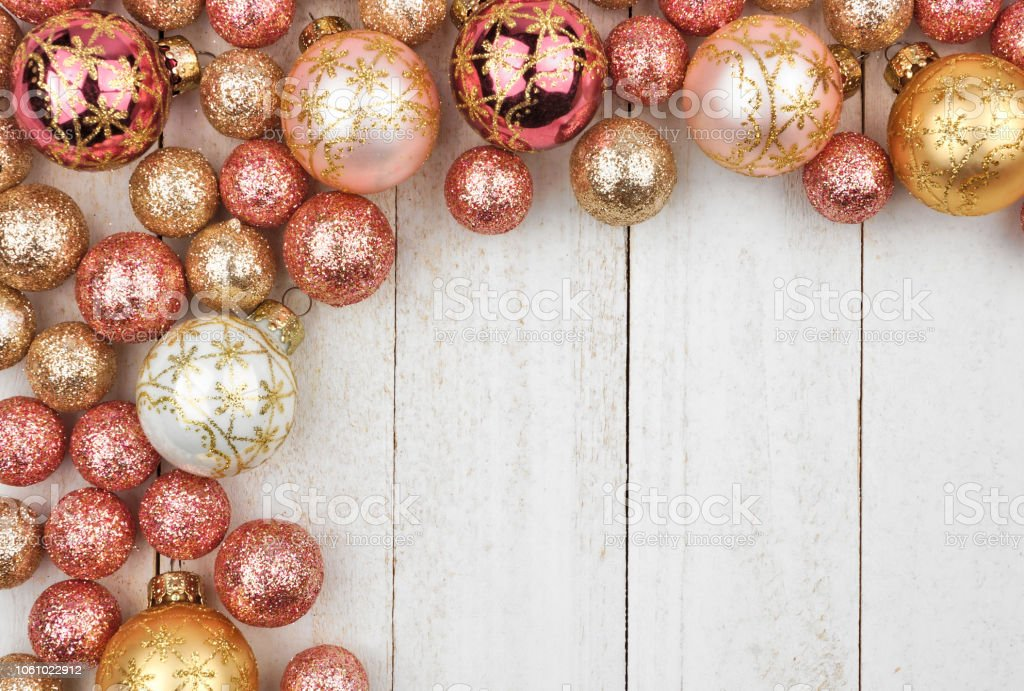 Christmas Corner Border Of Rose Gold And Golden Ornaments On White