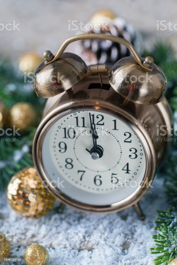 Christmas countdown to the new year. Clock and balls and fir spruce...