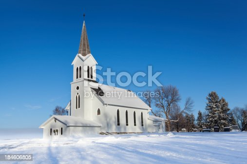 istock Christmas Country Church in Snowy Winter Scene Hz 184606805