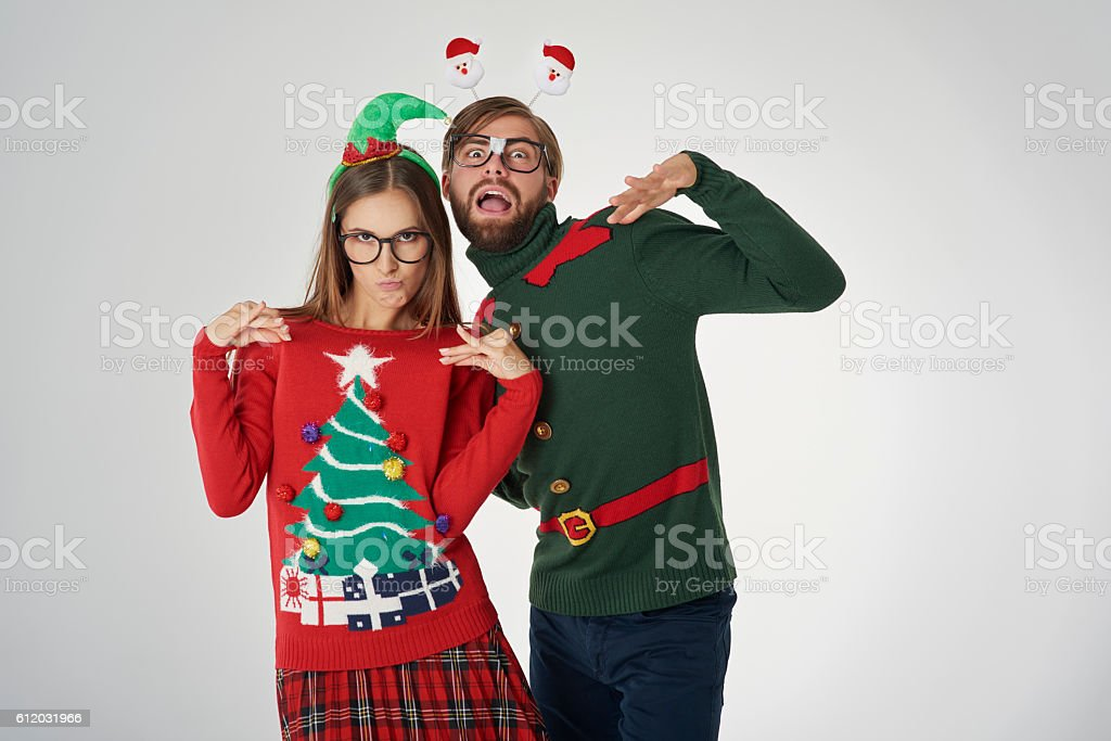 Christmas couple and funny poses stock photo
