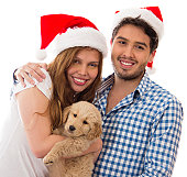Christmas couple with a puppy