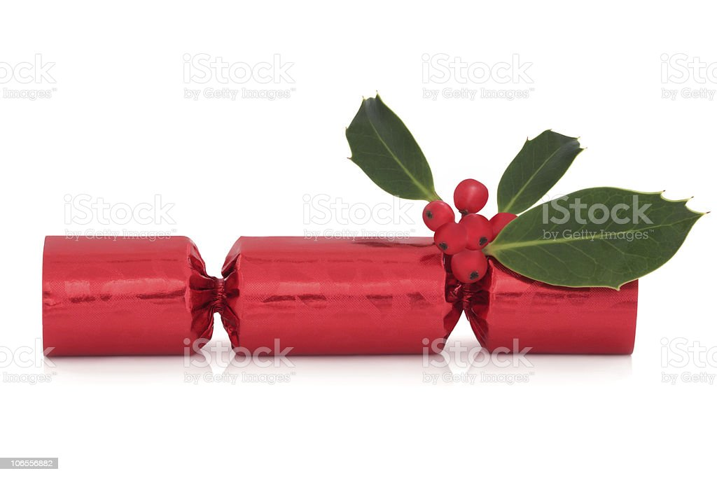 Christmas Cracker and Holly stock photo
