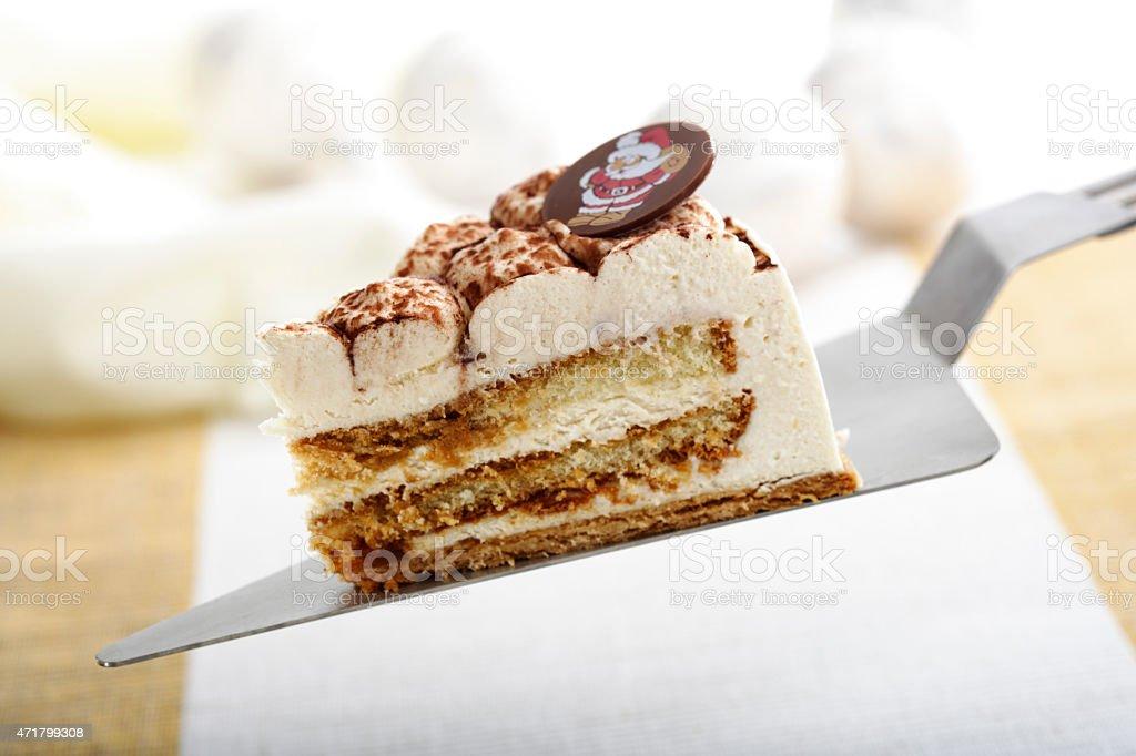 Christmas cream cake with on cake server stock photo