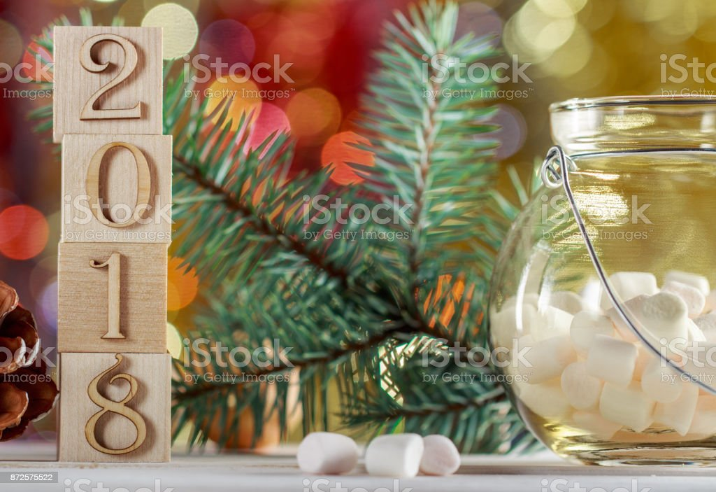 christmas cubes 2018 marshmallows in a glass jar on a blurred colored background a