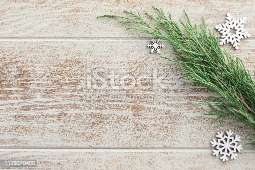 istock Christmas cypress branches border on a wooden background 1173270400