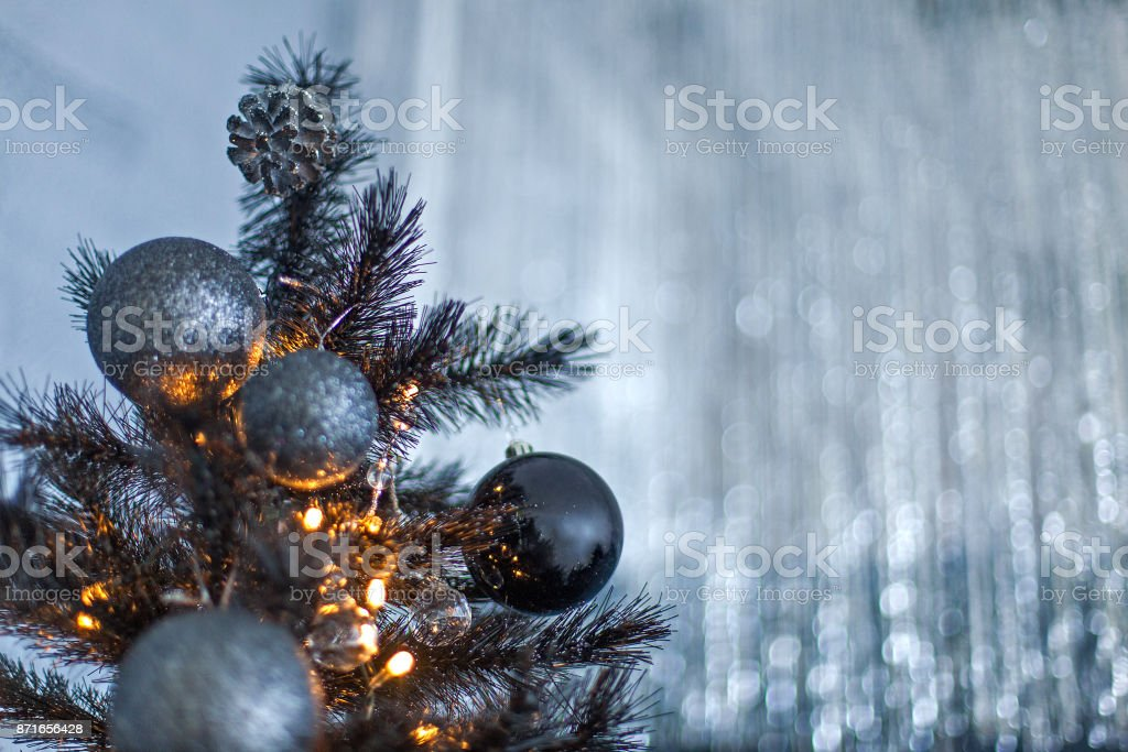 Black Christmas Ornaments.Christmas Dark Blurred Background With A Black Christmas